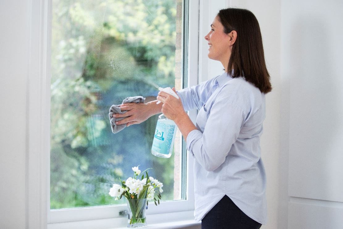 Woman spring cleaning at home