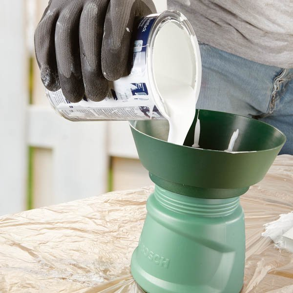 Paint sprayer in use