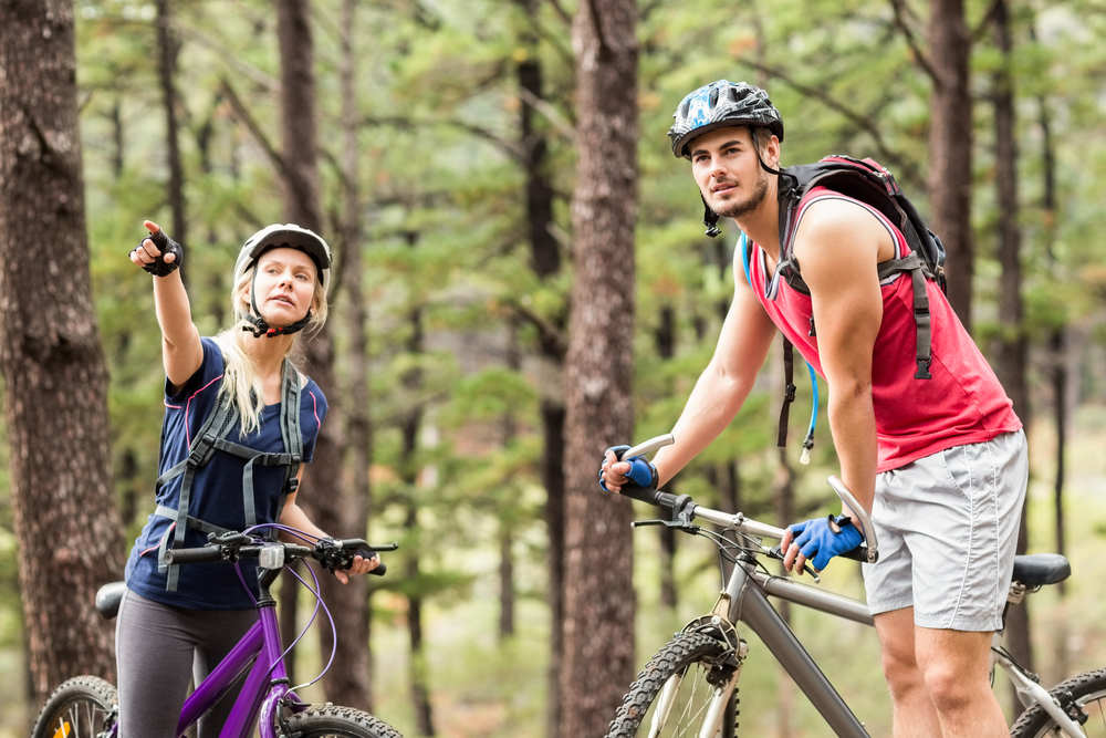 Couple on outdoor adventure with bikes